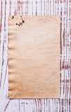 Old blank sheet of paper on wooden board with Stock Photo