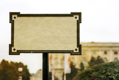 Old blank sign a blur background of the city Royalty Free Stock Image