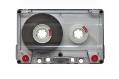 An old blank transparent audio cassette, isolated on white background Objects, Technology. royalty free stock image