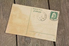 Old blank vintage postcard with old stamp Royalty Free Stock Photography