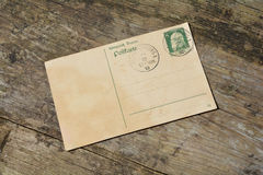 Old blank vintage postcard with old stamp Royalty Free Stock Image