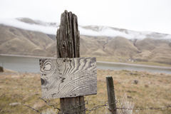 Old blank wooden signpost Stock Image