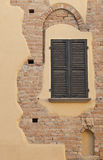 Old blind. Old Persian with nearby pieces of brick wall Stock Photo