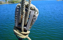 Old block with ropes on the ship Royalty Free Stock Image