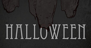 Old blood flows over white lettering halloween. Old thick blood flows over white lettering halloween Royalty Free Stock Photos