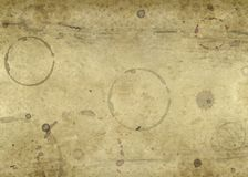 Old blotched paper background. Abstract full frame background showing a piece of old brown paper with lots of blots and spots Stock Image