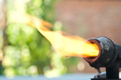Old blowtorch with fire Stock Image
