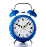 Old blue alarm clock. On  white Royalty Free Stock Photography