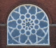 Old blue arched stained glass window Stock Photography