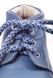 Old blue baby shoe Stock Image