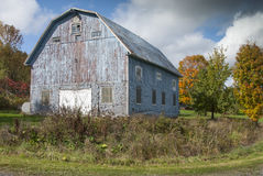 The old blue barn. This beautiful barn is located south of Montreal in the beautiful province of quebec. This autumn landscape and typical of our countryside Royalty Free Stock Photo