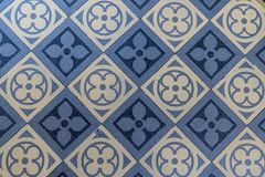 Blue and beige floor tiles. Old blue and beige floor tiles with geometric pattern royalty free stock image