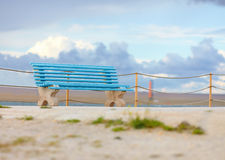Old blue bench on cloudy background Royalty Free Stock Images