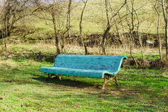 Old blue bench in the spring Park Royalty Free Stock Image