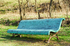 Old blue bench is in the spring Park Stock Photography