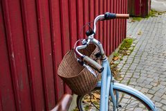 An old blue bike in a cobblestone street, retro vintage background stock photography