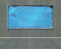 Old blue blank weathered noticeboard on dark green wooden wall Royalty Free Stock Images
