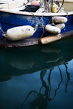 Old Blue  Boat With Floats and Reflections Stock Photos