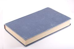 Old blue book  on white. Diagonal composition Royalty Free Stock Image