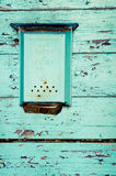 Old blue box for letters hanging on the wooden wall Royalty Free Stock Image
