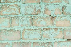 Old blue brick wall with peeling paint. stock image