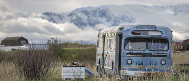 Old blue bus. An old derelict blue bus on the Homer Peninsula, Alaska possibly used during the fishing season stock image