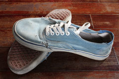 Old blue canvas shoe Stock Images
