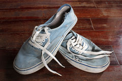 Old blue canvas shoe Stock Photos