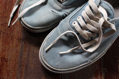 Old blue canvas shoe Royalty Free Stock Photos