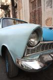 Old blue car right headlamp closeup Royalty Free Stock Photo