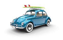 Old blue car with surfboard Stock Photo
