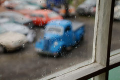 Out of focus old blue car from a window at a car cemetery Stock Images