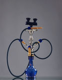 An old blue ceramic hookah on a grey background Royalty Free Stock Photography