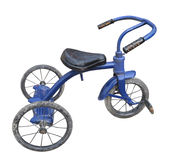 Old blue child's tricycle isolated. Royalty Free Stock Photography