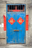 Old blue Chinese door with good fortune posters Stock Photography