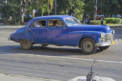 Old Blue Classic Cuban Car. Old blue driving by, Havana, Cuba Past international embargoes have meant Cuba has maintained many pre-revolutions vehicles Royalty Free Stock Images