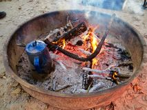 Old blue coffeepot boiling water on the campfire Royalty Free Stock Images