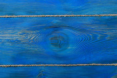 The old blue colored wooden texture background with old rope Royalty Free Stock Photos