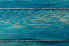 The old blue colored wooden texture background with old rope Royalty Free Stock Images