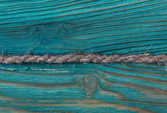 The old blue colored wooden texture background with old rope Stock Photography