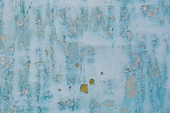 Old blue cracked paint on metal background royalty free stock image