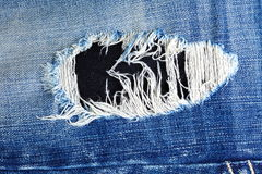 Old blue denim jeans Stock Images