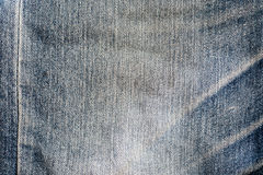 Old blue denim texture. Old grunge vintage blue denim jeans texture Stock Images