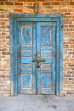 Old blue door. And red brick wall Royalty Free Stock Photos