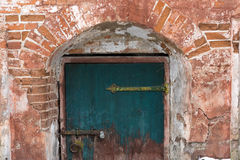 Old blue door. In the brick vault Royalty Free Stock Image