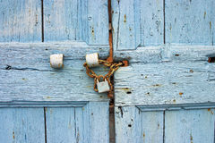 Old blue door detail. With rusty chain and padlock Stock Photography