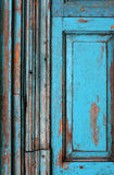 Old blue door. Detail of an old wooden blue door, very textural royalty free stock photo