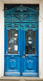 Old blue door with dusty cities stock images