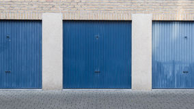 Old blue door of a garage Stock Photography