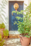 Old blue door with hat and flowers Stock Image